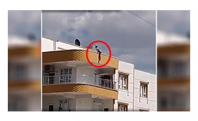 Siverek'te 3 katlı binanın çatısına çıkan genç intihar etmek istedi